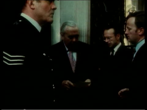 lib 1975 ext then prime minister harold wilson along from car to number 10 margaret thatcher wearing jumper with different european flags on pull... - harold wilson stock-videos und b-roll-filmmaterial