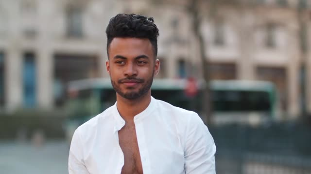 Theo Kimbaloula fashion blogger wears an Asos white collarless shirt Sand Copenhagen cropped pants a Time for Wood watch white sneakers shoes and and...