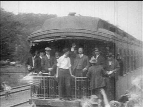 theodore roosevelt entourage waving from rear of train as it pulls away / documentary - theodore roosevelt us president stock videos & royalty-free footage