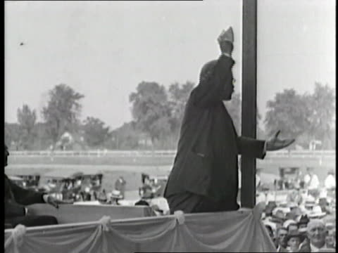 Theodore Roosevelt shouts and gestures while giving a speech