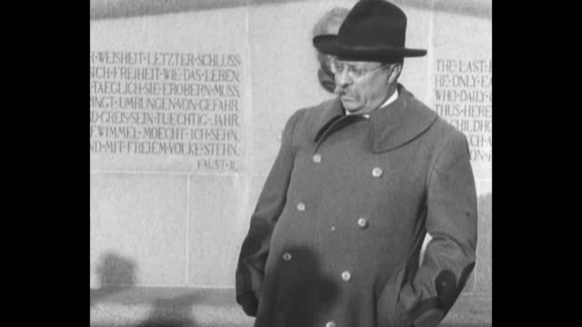 theodore roosevelt stands speaks at the johann wolfgang von goethe monument with a carving of goethe behind him with inscribed writings / note exact... - engraved image stock videos and b-roll footage