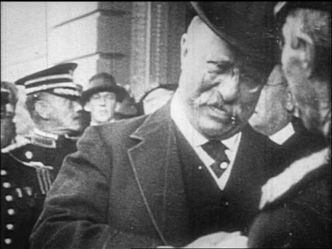 theodore roosevelt wearing top hat shaking hands with uniformed officer / documentary - theodore roosevelt us president stock videos & royalty-free footage