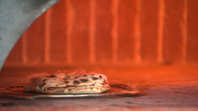 theo's pizzeria gvs; england: london: elephant and castle: int various shots chef kneeding pizza bases and applying toppings and placing pizzas in... - table stock videos & royalty-free footage