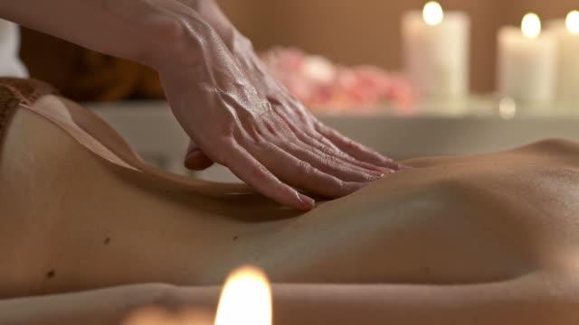 HD DOLLY: Therapist Massaging Woman's Back