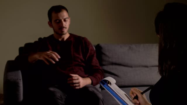 Therapy session, Mental health.depressed man talking with psychologist