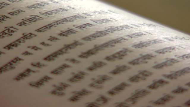 theravada buddhism. rack-focus side view of a section of a page containing a buddhist text in sanskrit. - theravada stock videos & royalty-free footage