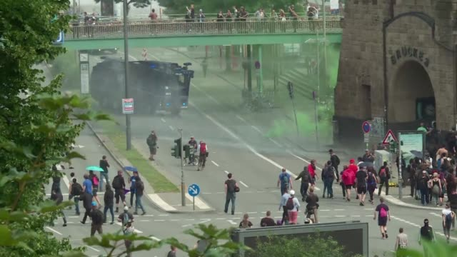 there are clashes between police and anti g20 protesters outside the venue where donald trump and vladimir putin met for the first time on friday - summit meeting stock videos and b-roll footage