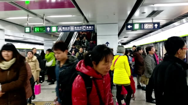 there are less people in beijing subway on rush hour because lots of people go back to hometown before chinese lunar new year - hometown stock videos and b-roll footage