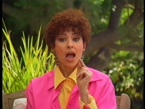 stockvideo's en b-roll-footage met there is a medium shot of rita moreno wearing a bright yellow blouse with a bright pink blouse over it she says the one thing i can say that i... - blouse