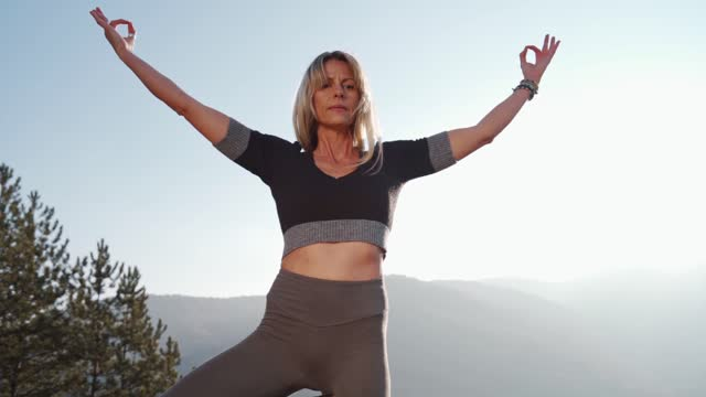 there is no rush in yoga practice - on one leg stock videos & royalty-free footage