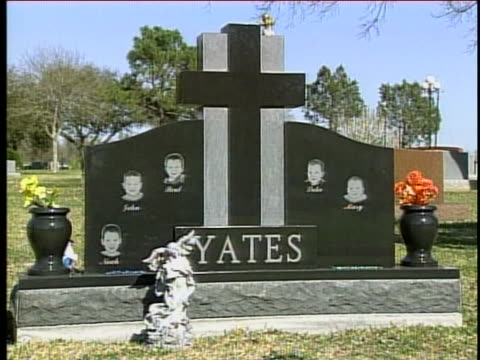 there is the headstone which has the name yates, and the pictures of the five children who were drowned by mother, andrea yates due to psychological... - postpartum depression stock videos & royalty-free footage