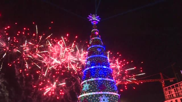 there were fireworks carols and plenty of festive spirit as officials in downtown beirut turned on lebanon's christmas lights - carol singer stock videos & royalty-free footage