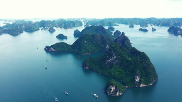 there's a reason why it's a top tourist attraction - halong bay stock videos and b-roll footage