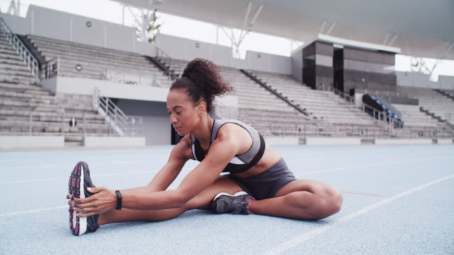 there's no substitute for stretching - warming up stock videos & royalty-free footage