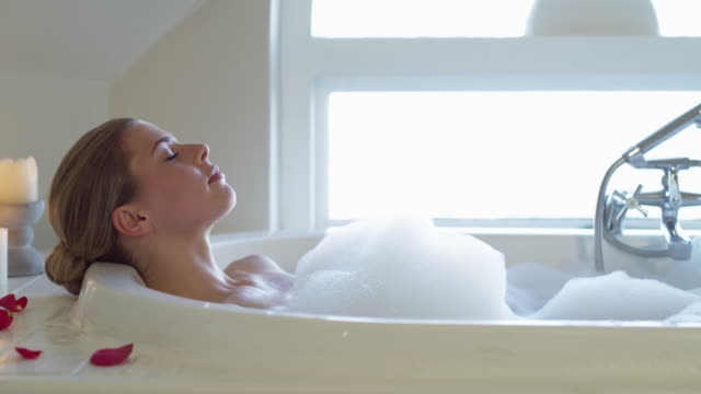 there's nothing s relaxing bath can't fix - vasca da bagno video stock e b–roll