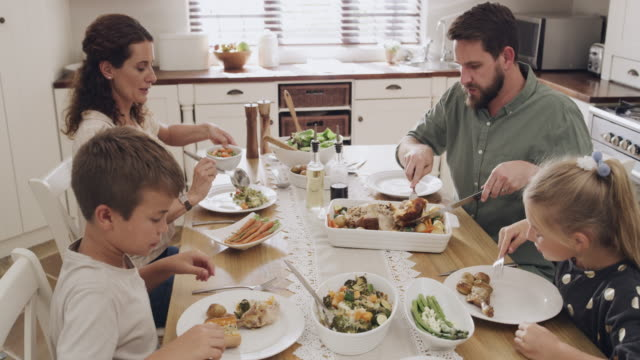 there's something extra special about sunday lunch - roast chicken stock videos & royalty-free footage