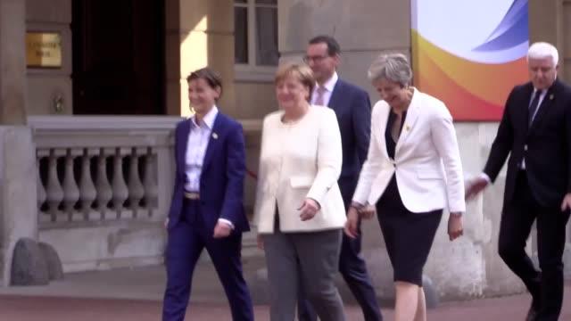 Theresa May and Angela Merkel leave the Western Balkans Summit at Lancaster House