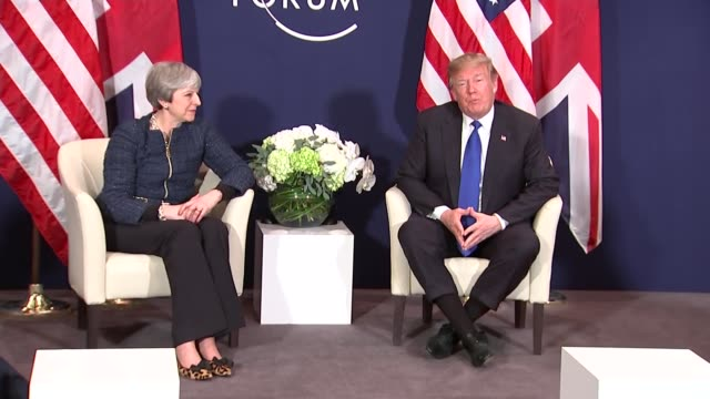 Theresa May and Donald Trump meet in Davos SWITZERLAND Davos INT Theresa May MP along arriving for press conference with Gavin Barwell Donald Trump...