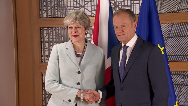 Theresa May and Donald Tusk shake hands for the press following what is believed to be an important step in Brexit negotiations on 8th December 2017