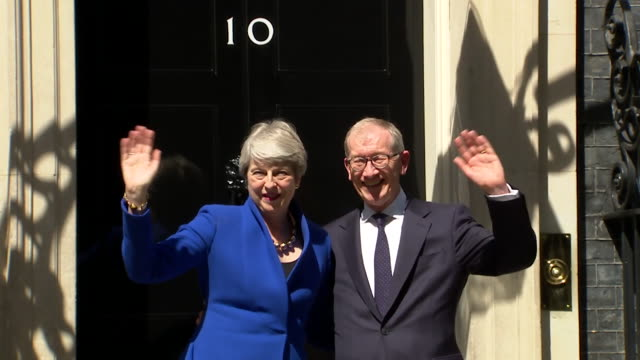 theresa may and husband philip wave from doorstep of number 10 downing street, after farewell speech, then head to buckingham palace to formally... - 10 downing street stock videos & royalty-free footage
