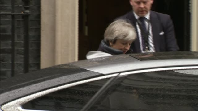theresa may and philip hammond departing downing street england london downing street ext theresa may mp departing number 10 and along to car / car... - downing street stock videos and b-roll footage