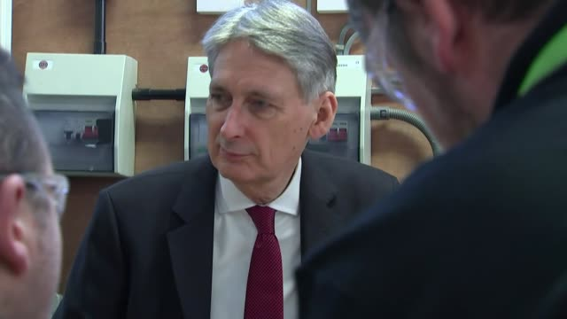 Theresa may and Philip Hammond visit to college in Leeds ENGLAND Yorkshire Leeds INT Theresa May MP and Philip Hammond MP visiting college chatting...