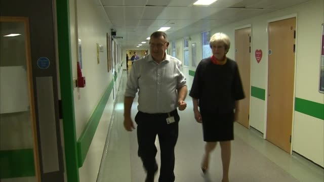 Theresa May apologises for cancelled operations as new figures reveal strain on NHS ENGLAND Surrey Frimley Park Hospital INT Theresa May MP along...