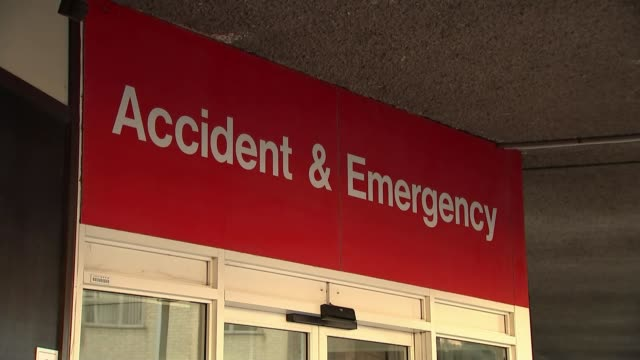 theresa may apologises for cancelled operations as new figures reveal strain on nhs t03011806 / 312018 addenbrooke's hospital ext sign over entrance... - casualty stock videos & royalty-free footage