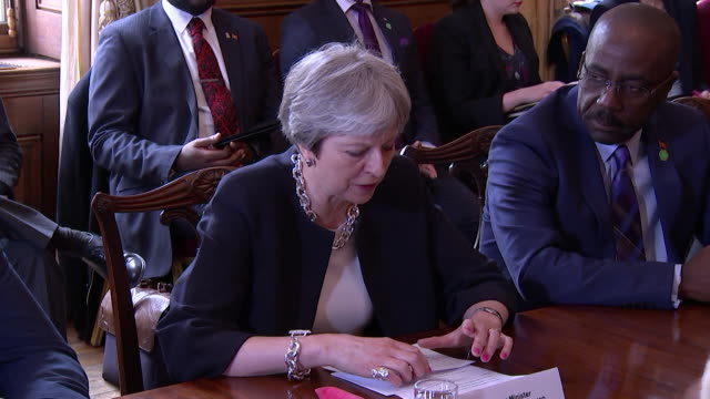 theresa may apologising to commonwealth leaders for the windrush controversy - versöhnung stock-videos und b-roll-filmmaterial