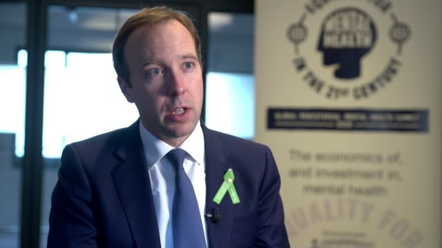 theresa may appoints first ever minister for suicide prevention to tackle mental health crisis england london int matt hancock mp speaking at podium... - minister stock-videos und b-roll-filmmaterial