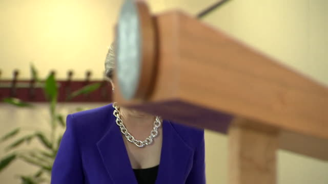 stockvideo's en b-roll-footage met theresa may approaching the lectern at the eu summit in brussels - parliament building