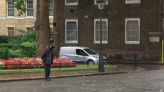 theresa may arrival at 10 downing street ahead of cobra meeting england london downing street ext motorcade arriving / theresa may mp out of car and... - motorcade stock videos & royalty-free footage