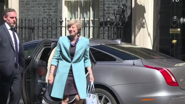 theresa may arrives in downing street for her first full day as britains new prime minister after a series of surprise appointments to her cabinet... - prime minister stock-videos und b-roll-filmmaterial