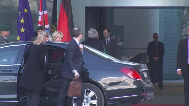 Theresa May arrives in Germany for talks with Angela Merkel GERMANY Berlin EXT Theresa May MP exiting car and greeting Angela Merkel