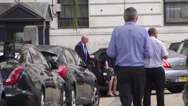Theresa May arriving at Downing Street holding the Budget Box