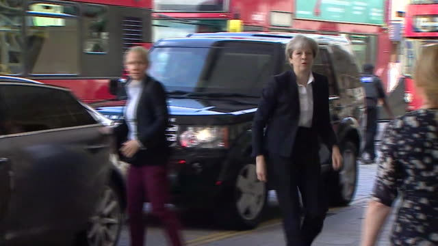 Theresa May arriving to meet casualties of the Grenfell Tower fire at a local hospital