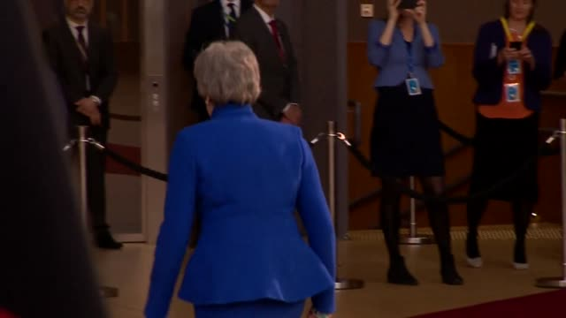 Theresa May at the EU in Brussels walking away from camera on the day she asked for a further extension to Brexit and Article 50