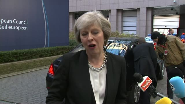 theresa may attends brussels summit ext theresa may mp speaking to press as arriving at eu summit sot i welcome the fact that the other leaders will... - trigger stock videos & royalty-free footage
