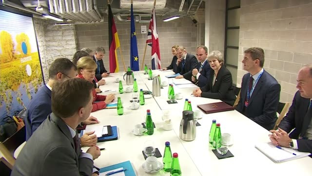 Theresa May attends EU Summit / JeanClaude Juncker comments on Brexit talks Tallin EU Summit INT Theresa May MP and Angela Merkel photocall seated...