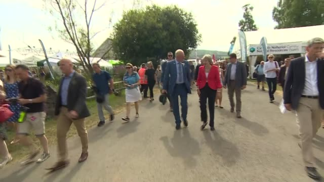 theresa may attends royal welsh show wales powys llanelwedd ext theresa may mp along / may at meeting - powys stock videos & royalty-free footage