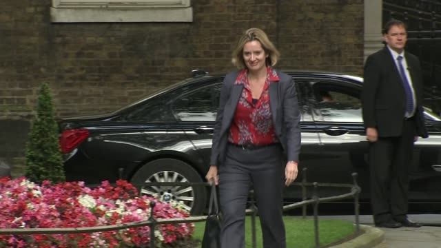 theresa may becomes new prime minister: cabinet appointments; england: london: ext various of amber rudd mp arriving at downing street - prime minister stock-videos und b-roll-filmmaterial