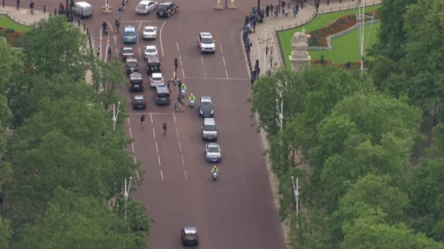 Handover of power AIR VIEWS May motorcade leaving Buckingham Palace and along streets to Downing Street