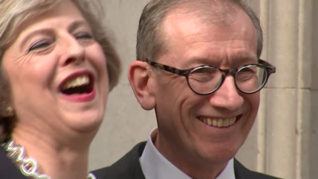 handover of power downing street ext theresa may and husband philip may waving from steps of number 10 - husband stock videos & royalty-free footage