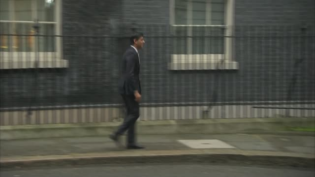 Theresa May completes cabinet reshuffle Downing Street EXT Rishi Sunak MP departing Number 10 Suella Fernandes MP departing Number 10 Fernandes along