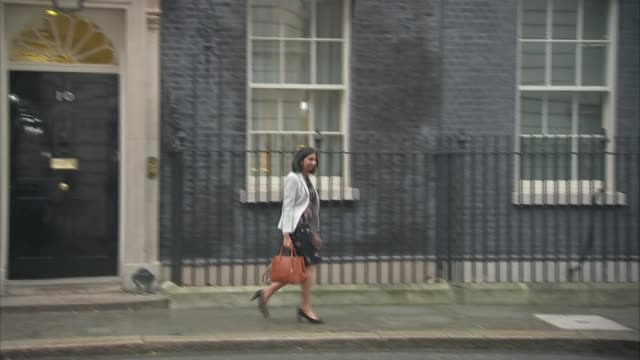 Theresa May completes cabinet reshuffle ENGLAND London Downing Street EXT Unidentified man departing Number 10 Alok Sharma MP along Downing Street...