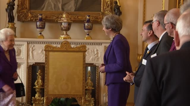 vídeos de stock, filmes e b-roll de theresa may curtseys as she meets the queen and prince charles at reception to mark 50th anniversary of investiture of prince of wales, buckingham... - primeiro ministro