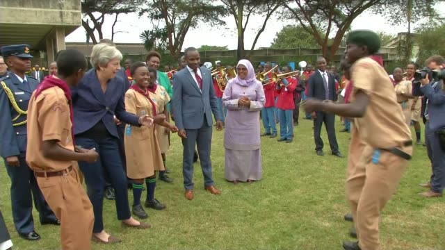 theresa may dances again during visit kenya nairobi ext various of british prime minister theresa may mp dancing during visit - theresa may stock videos & royalty-free footage