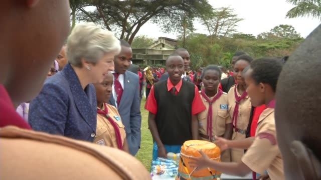 theresa may dances during visit to un scout project in nairobi kenya nairobi ext **music heard sot** theresa may mp along and dancing with scouts... - theresa may stock videos & royalty-free footage