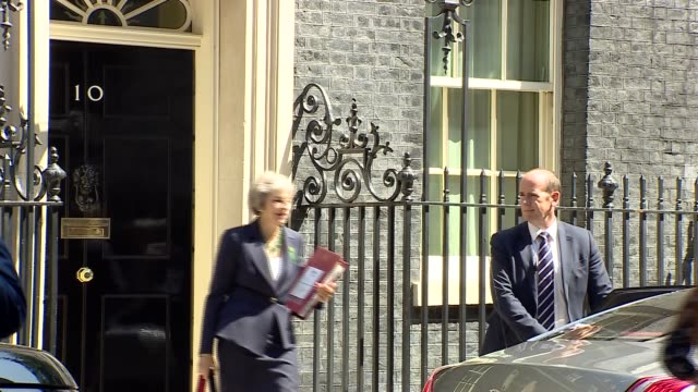 theresa may departs downing street for prime minister question's england london downing street ext theresa may mp from number 10 to car / car away - theresa may stock-videos und b-roll-filmmaterial