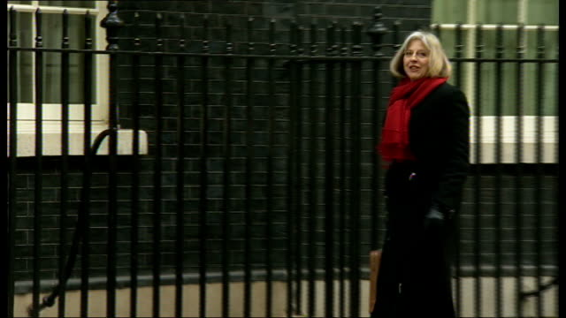 theresa may gets shoe stuck in downing street pavement crack england london downing street ext theresa may mp along and gets shoe caught in pavement... - downing street video stock e b–roll